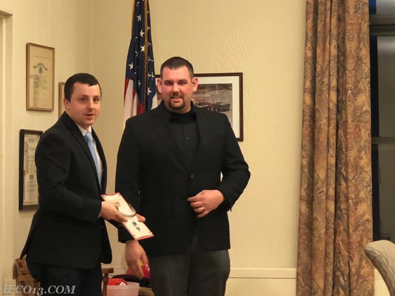 Raymond Zaccari presents 1st Lieutenant credentials to Jon Pucila  Photo Credit Mark Jackson